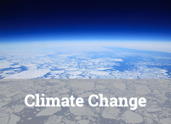 """View of melting polar ice from high altitude with text, """"Climate Change."""""""