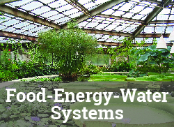 "Image of greenhouse interior with the label, ""Food-Energy-Water Systems."""