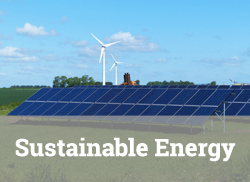 "Image of solar panels with wind generators in the background with text, ""Sustainable Energy."""